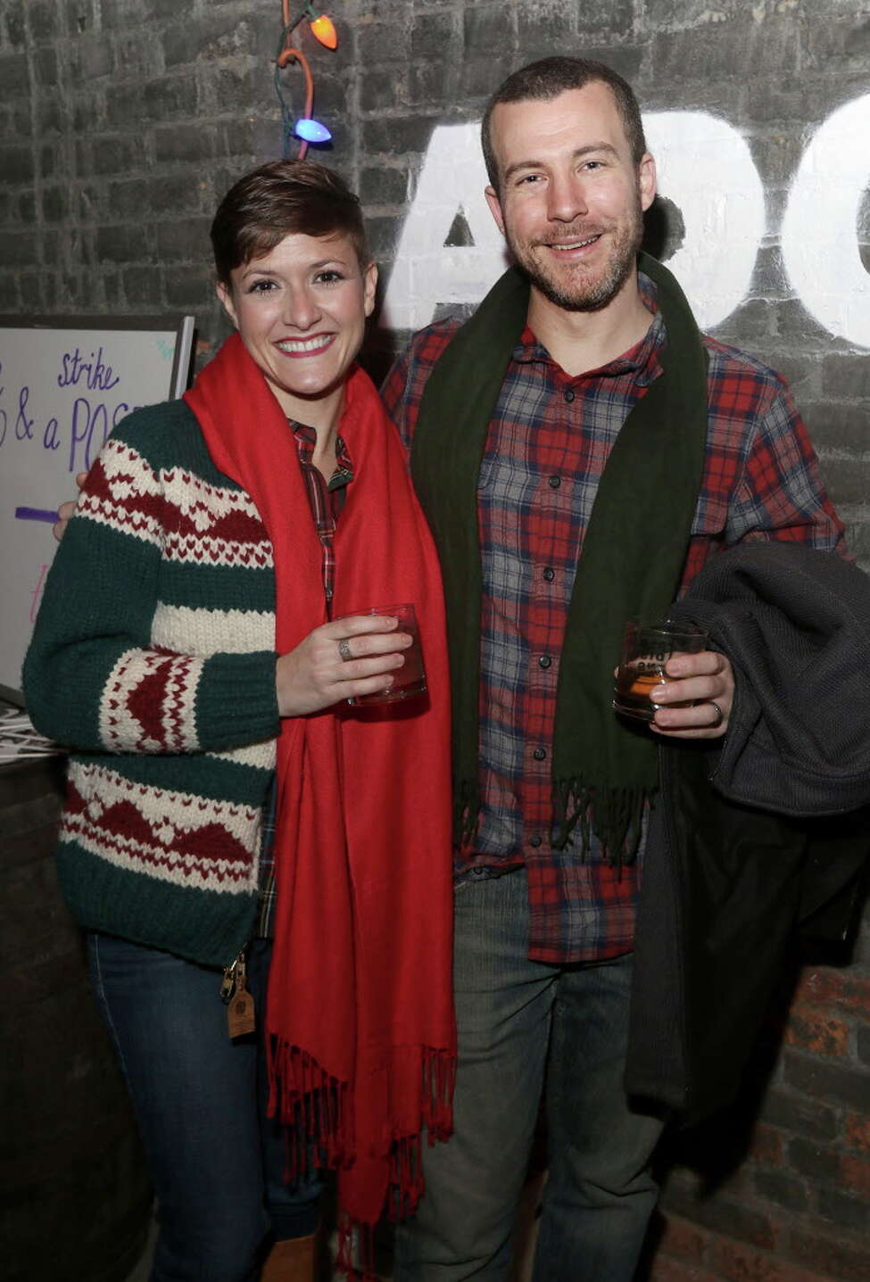 Albany, NY - December 17, 2016 - (Photo by Joe Putrock/Special to the Times Union) - Elizabeth Siegel(left) and Bryce Therrien(right) during the Albany Distilling Co.'s fourth annual-ish holiday party held at the distillery in downtown Albany. ORG XMIT: 08
