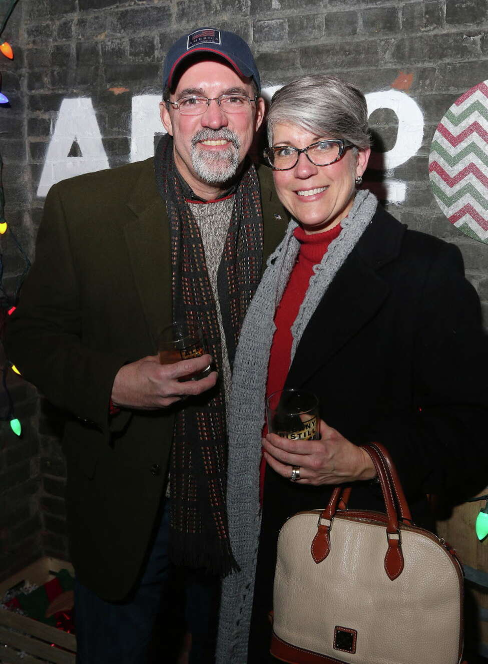 Albany, NY - December 17, 2016 - (Photo by Joe Putrock/Special to the Times Union) - Doug(left) and Beth(right) Slezak during the Albany Distilling Co.'s fourth annual-ish holiday party held at the distillery in downtown Albany. ORG XMIT: 10