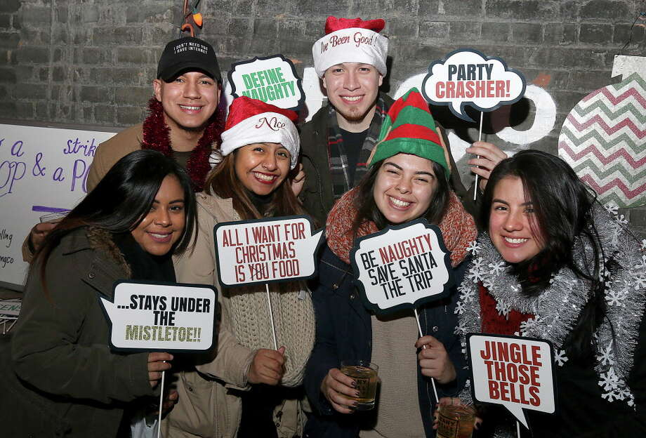 Albany, NY - December 17, 2016 - (Photo by Joe Putrock/Special to the Times Union) - (l to r) Brescia Lopez, Mike Santana, Zuleyma Pena, Giovanni Sillau, Johanna Buitrago and Laura Betancur during the Albany Distilling Co.'s fourth annual-ish holiday party held at the distillery in downtown Albany. ORG XMIT: 01 Photo: Joe Putrock, Albany Times Union / Joe Putrock