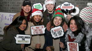 Albany, NY - December 17, 2016 - (Photo by Joe Putrock/Special to the Times Union) - (l to r) Brescia Lopez, Mike Santana, Zuleyma Pena, Giovanni Sillau, Johanna Buitrago and Laura Betancur during the Albany Distilling Co.'s fourth annual-ish holiday party held at the distillery in downtown Albany. ORG XMIT: 01
