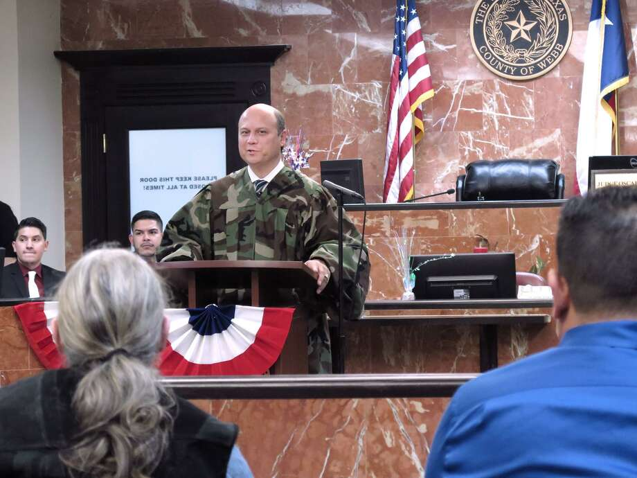406th District Judge Oscar J. Hale Jr., at podium, addresses five graduates, including Mark Nagele, 60, in black vest, of the Eight 406th and 341st District Courts Veterans Treatment Program Wednesday afternoon at the 406th Courtroom. This 13-month program is designed to help Veterans overcome struggles with drug and alcohol addiction and lead them on the path to sobriety and success. Upon completion of the program, all related charges are dismissed from their records. Photo: Cuate Santos /Laredo Morning Times / Laredo Morning Times