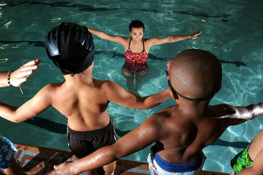 An instructor leads a swim lesson for children at the Bridgeport YMCA, in Bridgeport, Conn. in 2012. Beginning Saturday, adults will no longer be able to exercise at the Y's main branch in Bridgeport. Instead, the gym and pool facilities will be used for youth classes, school programs, camps and child care. Photo: Ned Gerard / File Photo