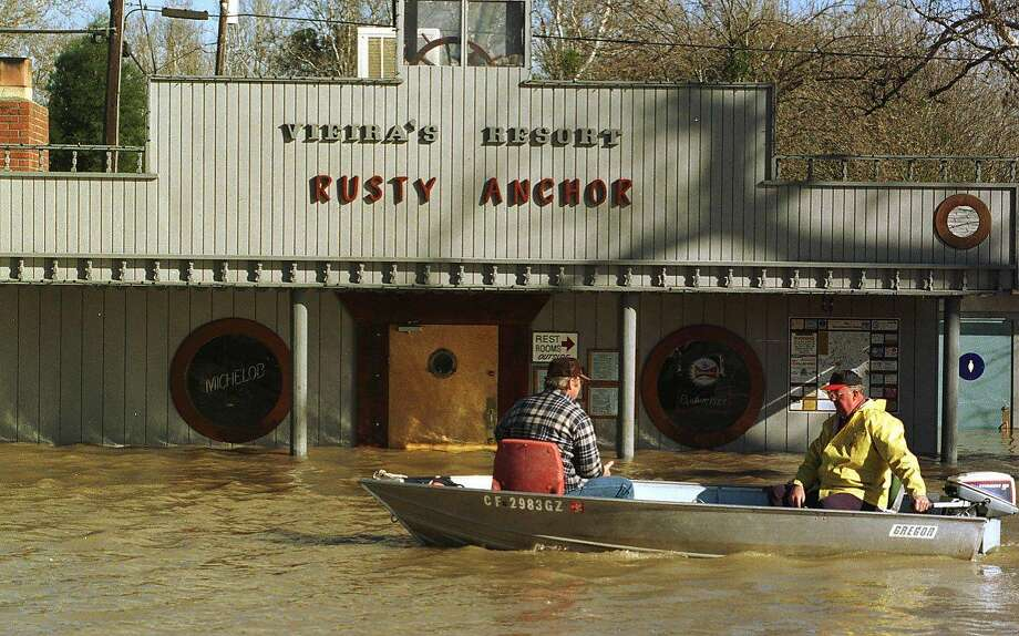 Home owners on their way to their flooded homes by boat in front of the flooded Rusty Anchor at Vieiras Resort on the Sacramento river in the delta, January 6, 1997 Photo: VINCE MAGGIORA
