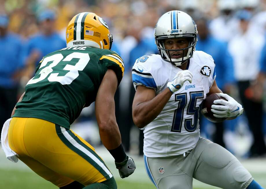 Golden Tate #15 of the Detroit Lions looks to make a move on Micah Hyde #33 of the Green Bay Packers in the third quarter at Lambeau Field on September 25, 2016 in Green Bay, Wisconsin. (Photo by Dylan Buell/Getty Images) Photo: Dylan Buell/Getty Images