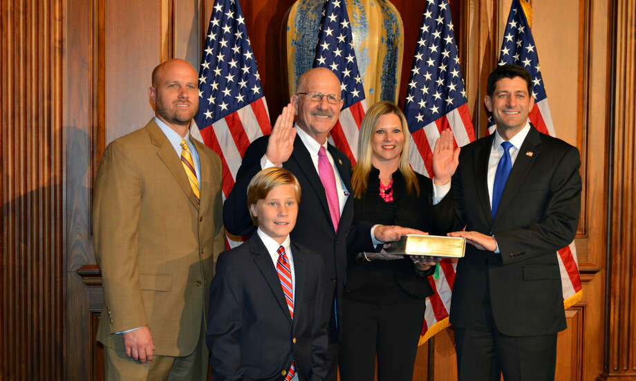 Congressman Ted Poe is sworn in for the 115th Congress by Speaker of the House Paul Ryan accompanied by Poe's son Kurt, daughter-in-law Suzy and grandson Jackson. Photo: Courtesy Photo