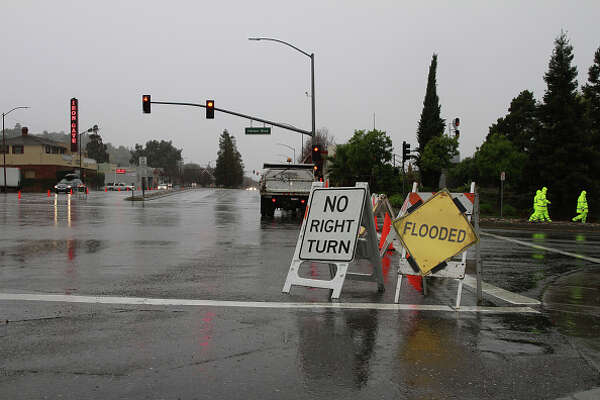 SAN FRANSISCO, CA, UNITED STATES - DECEMBER 11: Warning signs near a flooded area in the San Francisco Bay Area on December 11, 2014 as heavy rain and the powerfull storm hit Northern California. (Photo by Tayfun Coskun / Anadolu Agency / Getty Images)