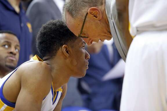 Golden State Warriors' assistant coach Ron Adams and Patrick McCaw against Portland Trail Blazers' during NBA game at Oracle Arena in Oakland, Calif., on Wednesday, January 4, 2017.