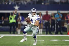 Dallas Cowboys' Dak Prescott rolls out of the pocket during an NFL football game against the Detroit Lions on Monday, Dec. 26, 2016, in Arlington, Texas. (AP Photo/Brandon Wade)