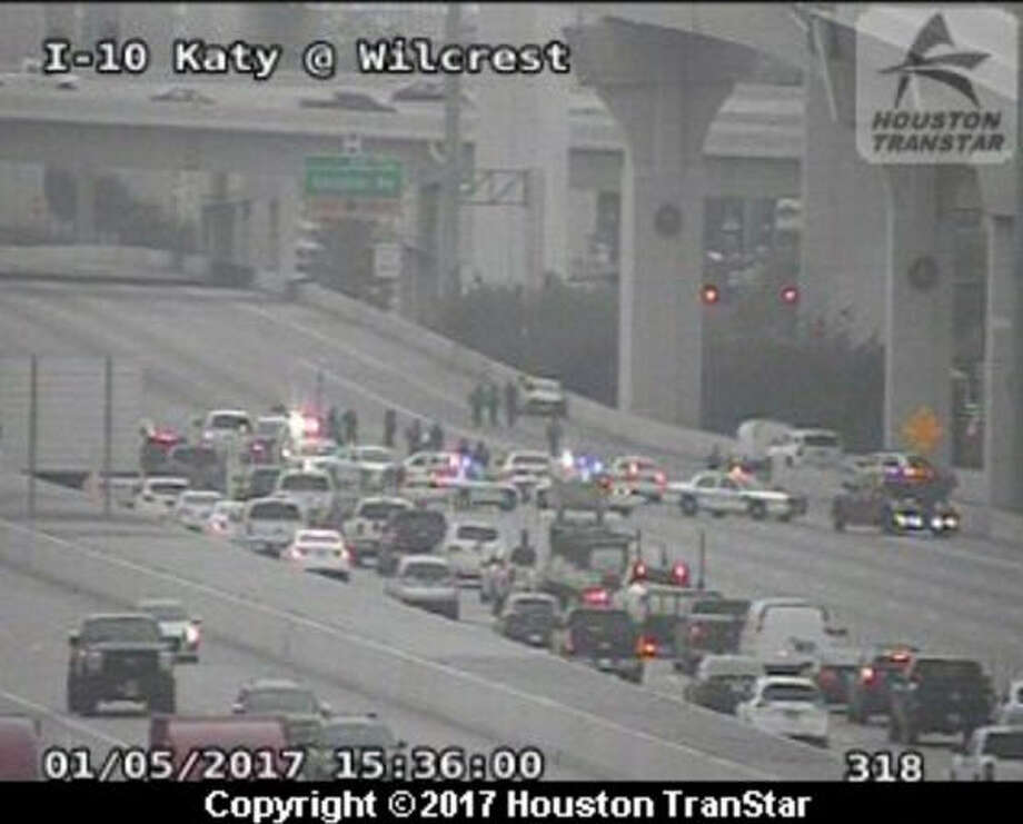 Eastbound Interstate 10 was closed Thursday afternoon at the Sam Houston Tollway near Memorial City, as police investigated a potentially fatal accident. Photo: Houston TranStar