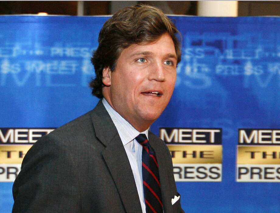 FILE - In this Nov. 17, 2007 file photo, political commentator Tucker Carlson arrives for the 60th anniversary celebration of NBC's Meet the Press at the Newseum in Washington. Fox News Channel says that veteran pundit Carlson will replace Megyn Kelly in the network's coveted 9 p.m. time slot sandwiched between Bill O'Reilly and Sean Hannity. Kelly announced on Tuesday, Jan. 3, 2017, that she is leaving Fox to go to NBC News.  (AP Photo/Charles Dharapak, File) Photo: Charles Dharapak, Associated Press