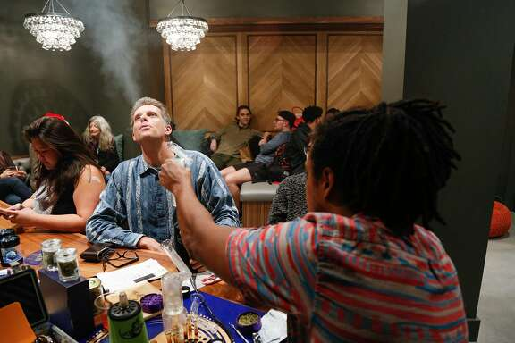 From left, Mark Cunningham blows out vapor from one of Tyler Williams' VapeXhale vaporizers at Harvest, a new dispensary in the Bernal Heights neighborhood. Harvest celebrated it's grand opening Thursday evening, December 15, 2016 in San Francisco. Brian Feulner, Special to the Chronicle