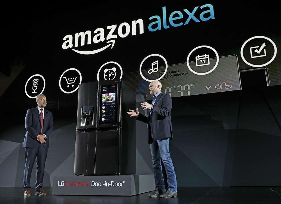 LG Electronics' David VanderWaal and Amazon Echo's Mike George present the LG Smart InstaView Door-in-Door Refrigerator at CES. Photo: Jack Dempsey, Associated Press