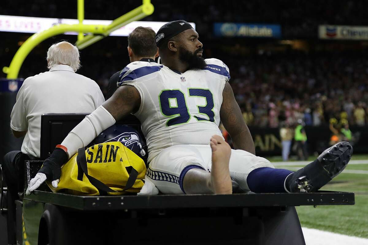 Tony McDaniel #93 of the Seattle Seahawks is injured during a game against the New Orleans Saints at the Mercedes-Benz Superdome on October 30, 2016 in New Orleans, Louisiana. (Photo by Jonathan Bachman/Getty Images)