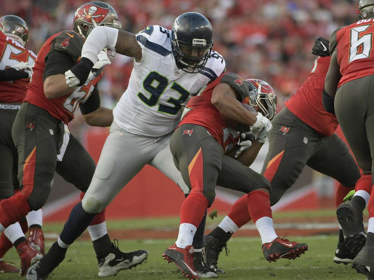 Seattle Seahawks defensive tackle Tony McDaniel (93) stops Tampa Bay Buccaneers running back Doug Martin during the second quarter of an NFL football game Sunday, Nov. 27, 2016, in Tampa, Fla. (AP Photo/Phelan Ebenhack)
