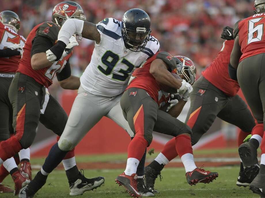 Seattle Seahawks defensive tackle Tony McDaniel (93) stops Tampa Bay Buccaneers running back Doug Martin during the second quarter of an NFL football game Sunday, Nov. 27, 2016, in Tampa, Fla. (AP Photo/Phelan Ebenhack) Photo: Phelan Ebenhack/AP