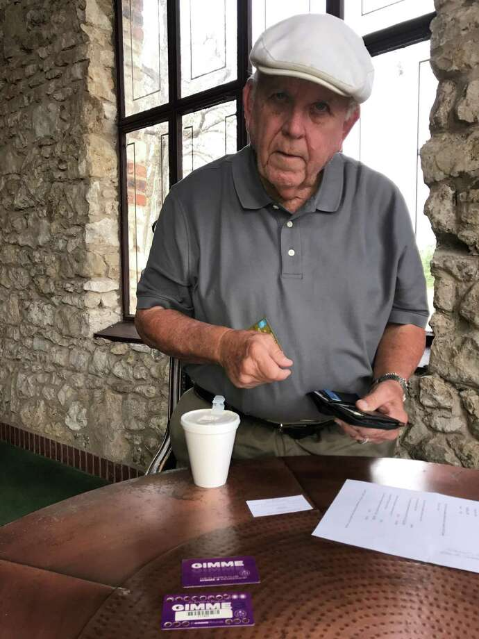 Retiree Robert Wilmore says a new pricing structure could force him to cut back on golf. Photo: Roy Bragg / San Antonio Express-News