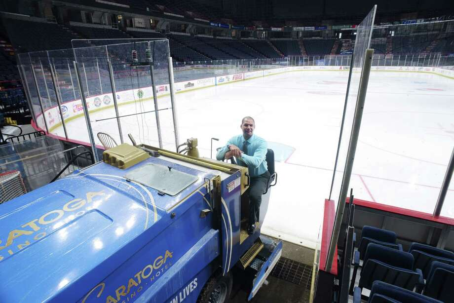 Nathan Sims, director of operations at the Times Union Center, poses with a zamboni on Wednesday, Jan. 4, 2017, in Albany, N.Y.  (Paul Buckowski / Times Union) Photo: PAUL BUCKOWSKI / 20039308A