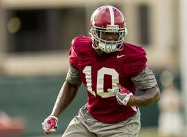 FILE - In this Sept. 26, 2016, file photo, Alabama linebacker Reuben Foster (10) works through drills during the NCAA college football team's practice, in Tuscaloosa, Ala. Foster was selected to the 2016 AP All-America college football team, Monday, Dec. 12, 2016. (Vasha Hunt/The Birmingham News via AP, File)