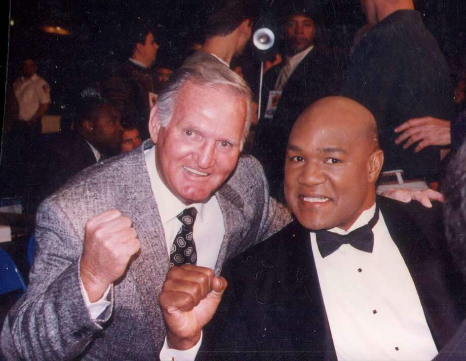 Longtime boxing timekeeper Bill Gavin poses with former world champion George Foreman at an event. Gavin, 86, died Dec. 20 at his North Side home; he had been diagnosed with melanoma. Photo: Courtesy Photo