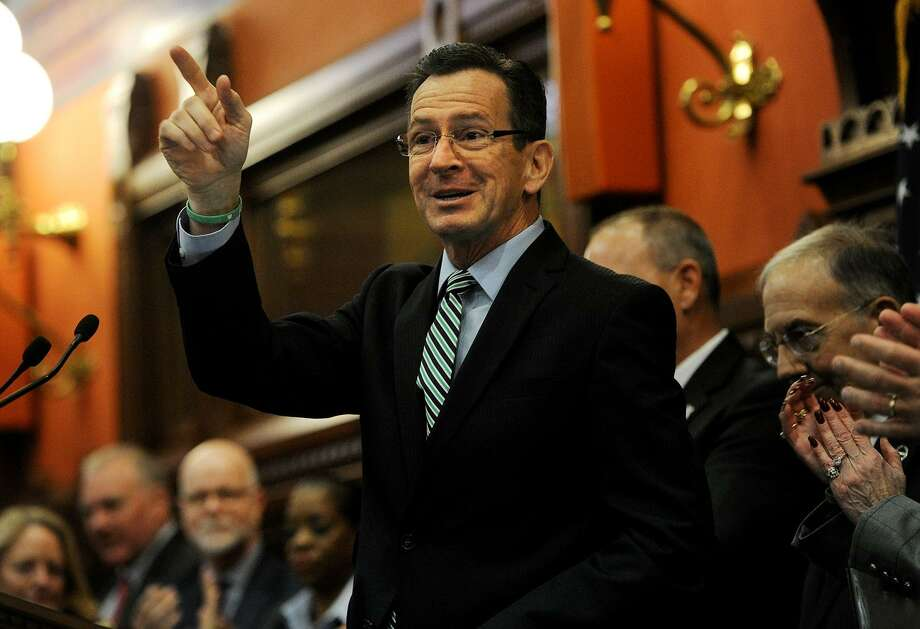 Governor Dannel P. Malloy points after addressing a packed House chamber during the opening day of the General Assembly at the Capitol in Hartford on Wednesday. Below, Photo: Brian A. Pounds / Hearst Connecticut Media / Connecticut Post
