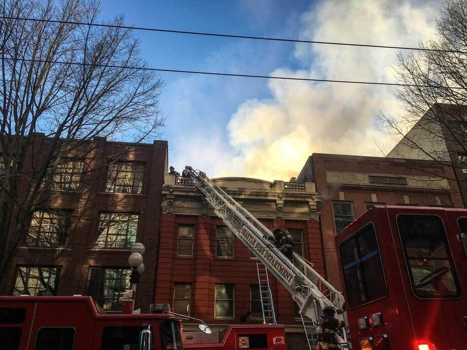 Seattle fire crews battle a blaze at 1919 First Avenue downtown. Photo: Genna Martin/seattlepi.com