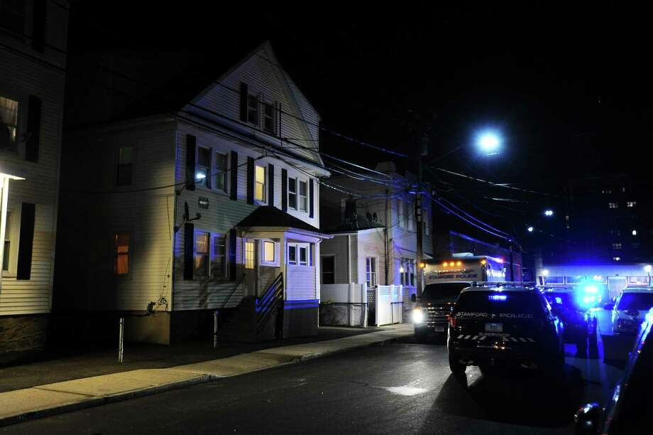 Stamford police are investigating the death of a man who was found between two homes on Spruce Street late Thursday afternoon. Police say they are working to determine the cause of the man's death. Photo: Michael Cummo / Staff / Stamford Advocate