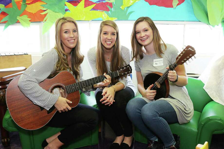 Erin McNair-Duff, librarian at Colbert Elementary, with her sisters Meredith and Claire McNair are all three gifted singers and performers. Meredith and Claire entertained students at Colbert Elementary on the first day back to school from winter break. Photo: David Taylor
