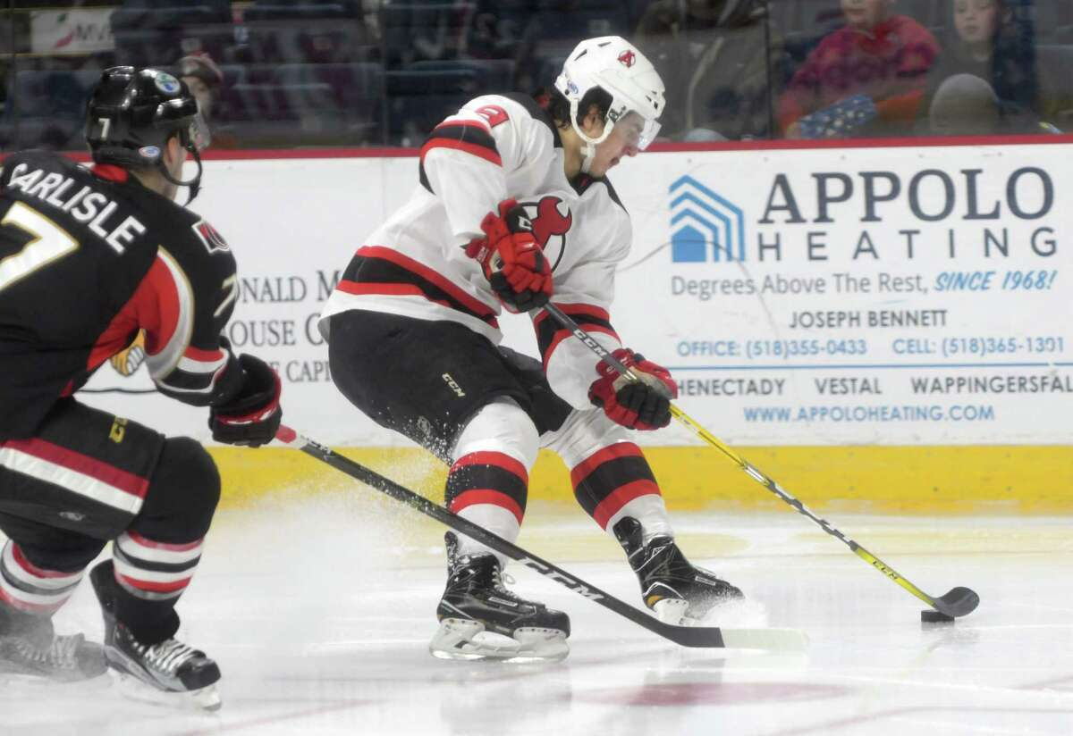 Joe Blandisi, right, with the Albany Devils brings the puck around a Binghamton Senators player during their game on Sunday, Dec. 4, 2016, in Albany, N.Y. (Paul Buckowski / Times Union) ORG XMIT: MER2016120419472318