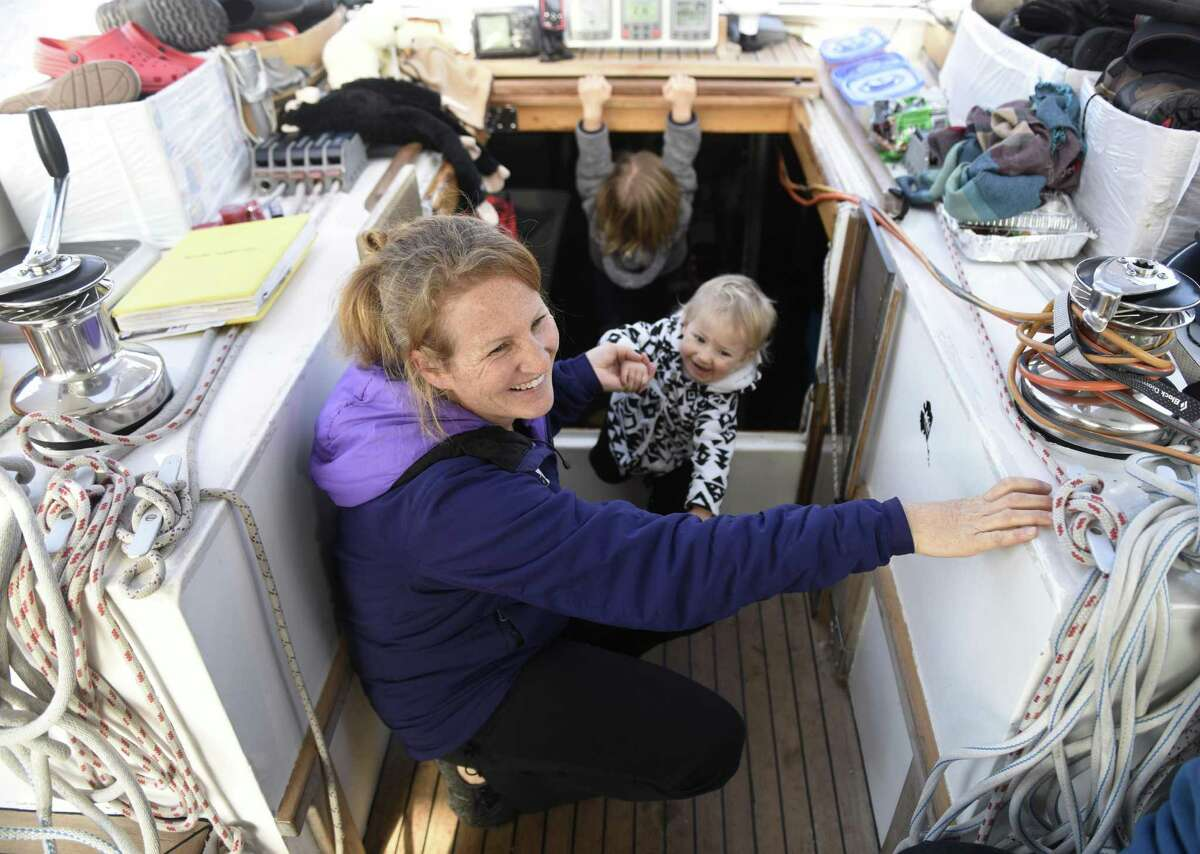 Sabine Schwörer and her daughter, Mia, 1, hang out on the deck of their 50-foot sailboat docked at Indian Harbor Yacht Club in Greenwich.
