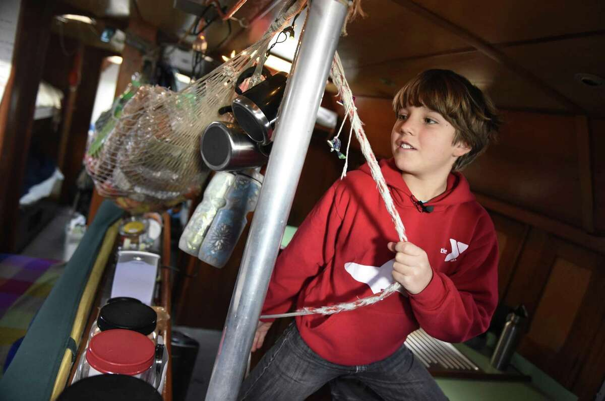Andri Schwörer, 10, shows the main cabin room in his family's 50-foot sailboat . Climatologist Dario Schwörer, his wife Sabine and their five children are the leaders of the TOPtoTOP Global Climate Expedition, which has circumnavigated the globe conducting field-based research, visiting remote regions and sharing solutions to protect and preserve the planet from climate change. The family lives on the boat, which made a two-week stop in Greenwich before heading off to sea again after the New Year.