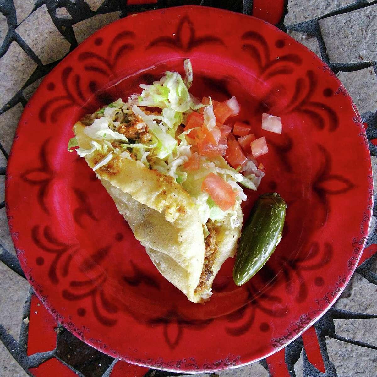 Ray's Drive Inn: Beef picadillo puffy taco. 822 SW 19th St., 210-432-7171, raysdriveinn.net