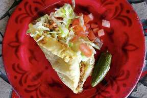 Ray's Drive Inn: Beef picadillo puffy taco. 822 SW 19th St., 210-432-7171, raysdriveinn.net