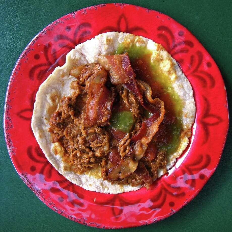 A taco with beans, chorizo and bacon on a handmade corn tortilla from Benny's Tacos on Walzem Road. Photo: Mike Sutter /San Antonio Express-News