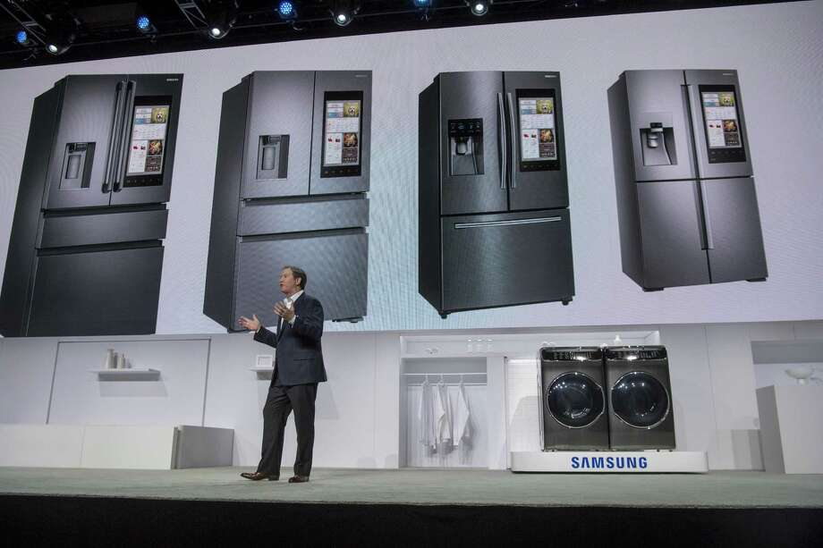 John Herrington, senior vice president at Samsung Electronics America Inc., stands in front of the FlexWash washing machine and FlexDry dryer as he speaks during the company's event at the 2017 CES tech show in Las Vegas. Samsung, Whirlpool and other manufacturers are unveiling new ways to use voice services to control laundry machines, refrigerators and other home systems. Photo: David Paul Morris /Bloomberg News / © 2017 Bloomberg Finance LP
