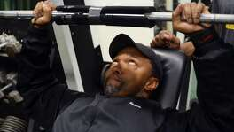 """Gary Shields, 56, bench presses a set of weights at God's Gym located at 2501 Broadway in Oakland, California. Shields has owned the gym for three decades, where he shares his love of body-building and community support. """" If I can help you build a life that's good, right, and true, I'm all for it!"""""""
