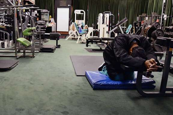 Gary Shields, owner of God's Gym located at 2501 Broadway in Oakland, takes a moment to pray before he opens up  up his business to the early morning workout crew which arrive at 4:30 A.M. December 2nd, 2016