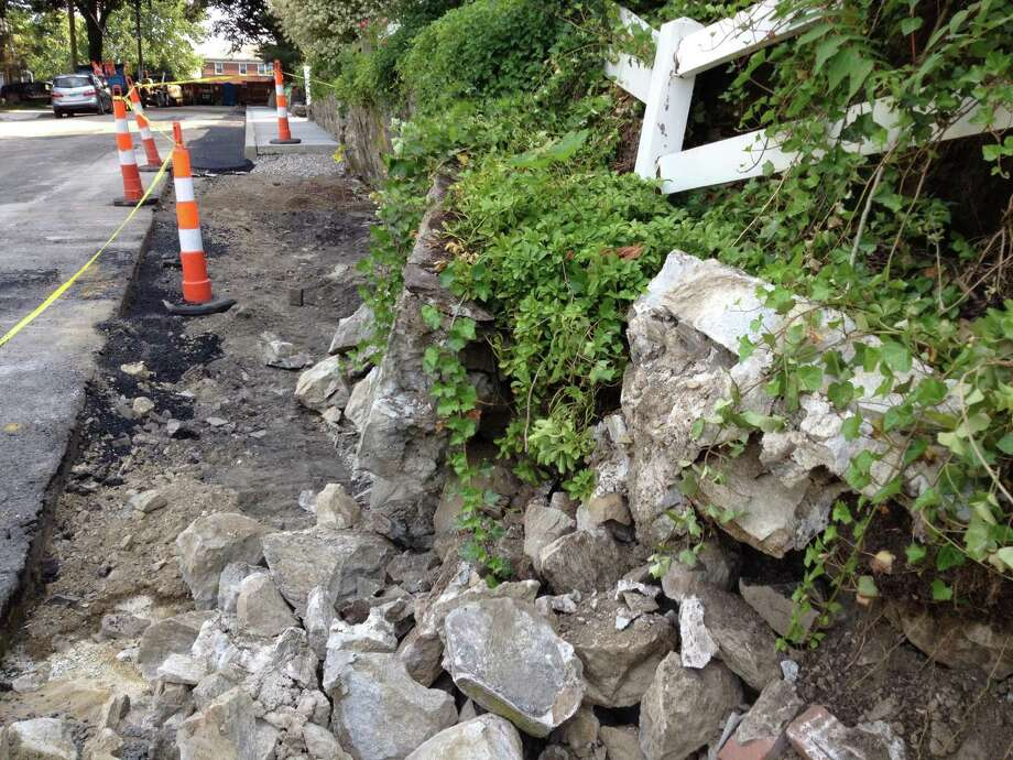 A Stamford contractor installing sidewalks on Nash Place in Glenbrook damaged a retaining wall surrounding the home of Jon Saunders in Stamford. Photo: Contributed / Contributed Photo / Stamford Advocate  contributed