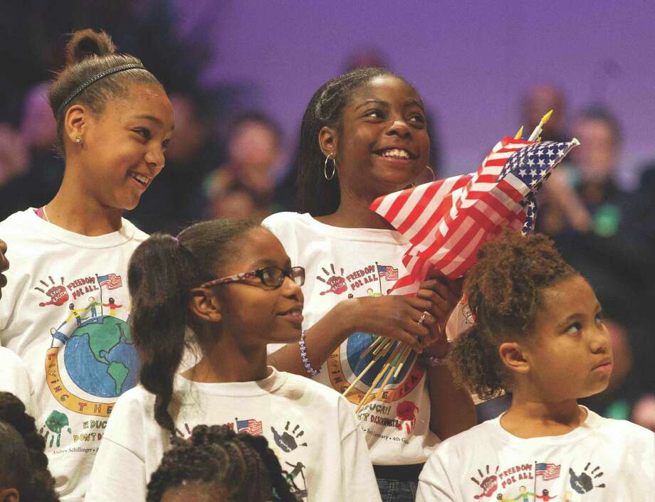 Members of the Children's Mass King Choir smile after performing 'America the Beautiful' during the annual commemorative celebration honoring Dr. Martin Luther King Jr. in The Woodlands Monday. Photo: Jason Fochtman / The Conroe Courier