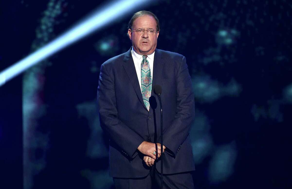 Chris Berman introduces the In Memoriam tribute at the ESPY Awards at the Nokia Theatre on Wednesday, July 16, 2014, in Los Angeles. (Photo by John Shearer/Invision/AP) ORG XMIT: CABS174 ORG XMIT: MER2016011114541681