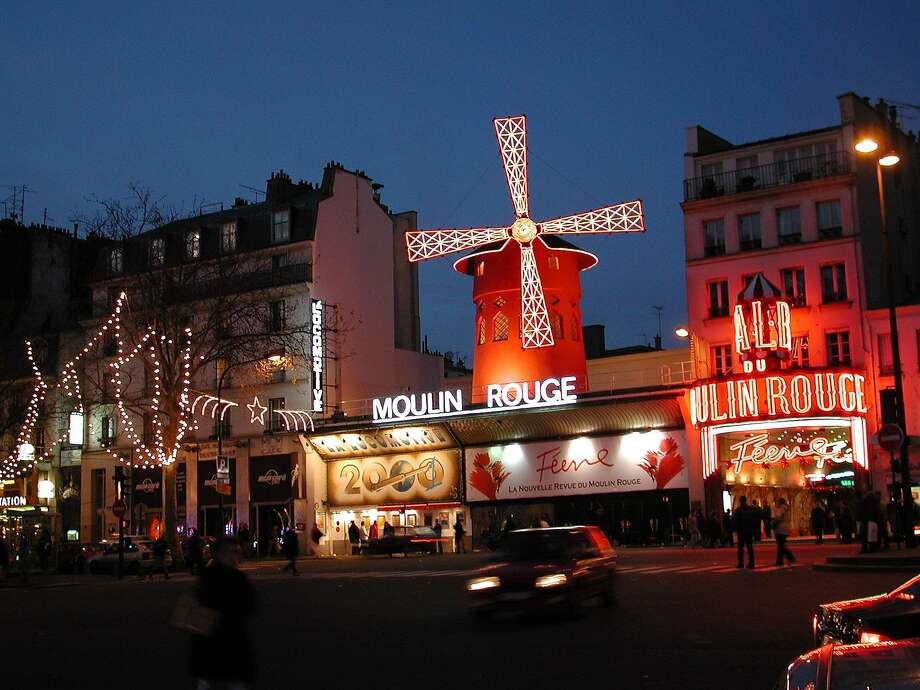 The famous Moulin Rouge dance hall, where cancan kickers have been taking the stage since 1889, is on the fringe of Montmartre on the north side of Paris. Photo: Rick Steves