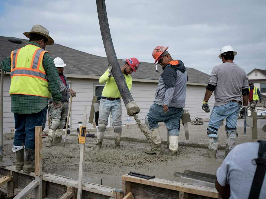 Construction workers pour a concrete foundation in the Carmona Hills neighborhood by KB Home on the Southwest Side of San Antonio in 2017. The U.S. economy grew at a solid rate of 2.6 percent in the final three months of last year, helped by a big rebound in home construction and the fastest consumer spending since the spring of 2016. Photo: Matthew Busch /For The Express-News / © Matthew Busch