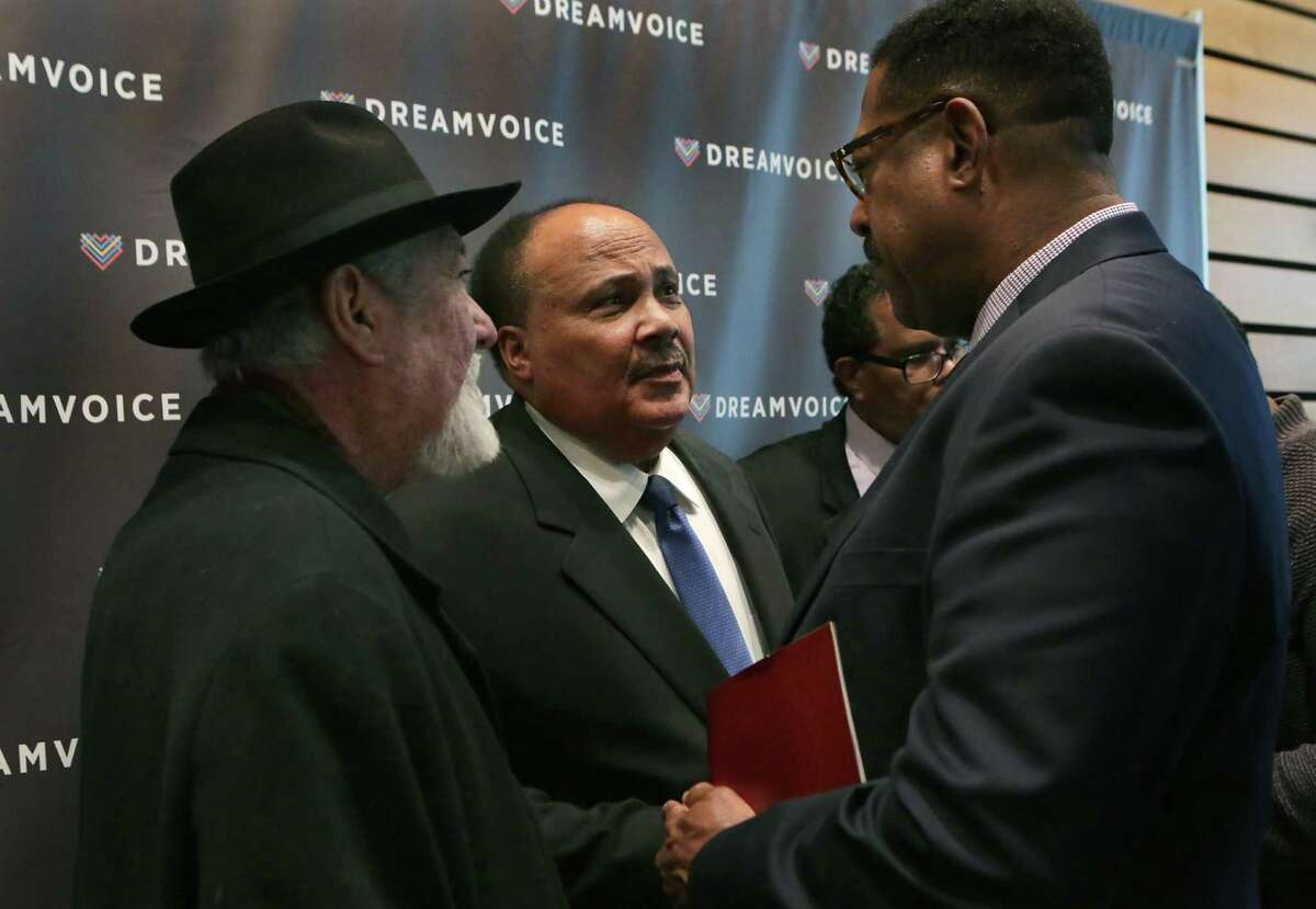 Martin Luther King III, center, talks with Jaime Martinez, left, and Morehouse College classmate Byron Miller, at Dreamweek San Antonio 2016 Opening Breakfast Ceremony on Friday, Jan. 8, 2015, at Briscoe Western Art Museum. King kicked off the event as the keynote speaker.