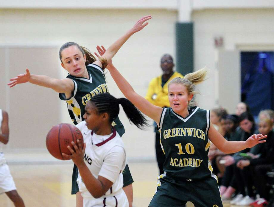 Greenwich Academy defenders Cora Creighton (11), left, and Brook Powers (10), right, pressure King's Alonna Christy, foreground, who is attempting to pass the ball during the girls high school basketball game between Greenwich Academy and King School at Greenwich Academy, Greenwich, Conn., Thursday, Jan. 5, 2017. GA defeated King, 62-29. Photo: Bob Luckey Jr. / Hearst Connecticut Media / Greenwich Time