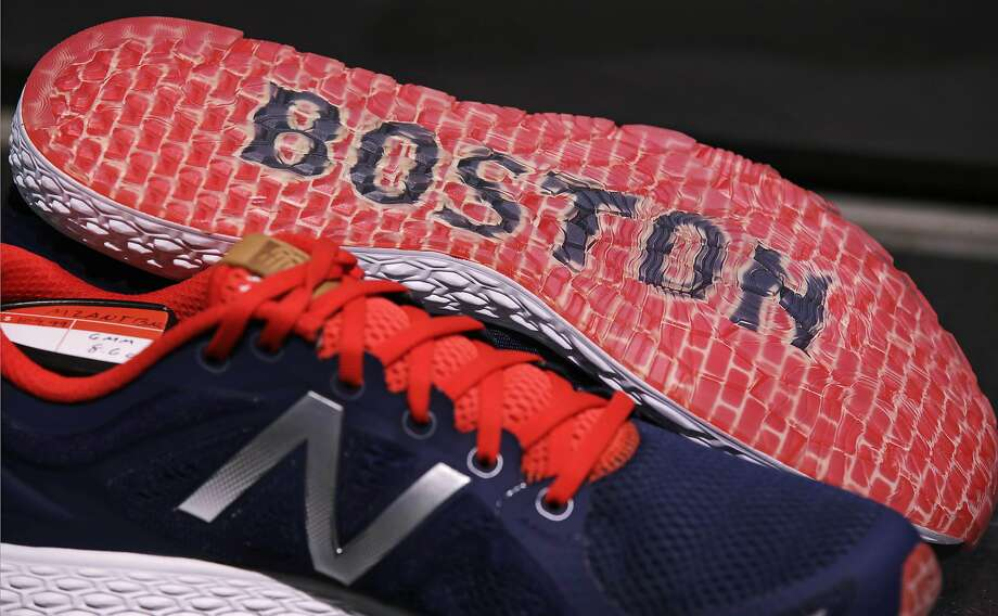 "In this Wednesday, Dec. 28, 2016 photograph, the word ""Boston"" accents the sole of the New Balance Zante v2 shoe on display at the storefront of the world headquarters of New Balance in the Brighton neighborhood of Boston. Some of America's top sneaker makers are racing to the Boston area. Reebok picked the city's Seaport District for its new global headquarters in December. Homegrown Boston-area companies New Balance and Converse opened new offices in 2015. Industry watchers said the boldly designed headquarters are partly a bid to lure millennial talent. (AP Photo/Charles Krupa) Photo: Charles Krupa, Associated Press"