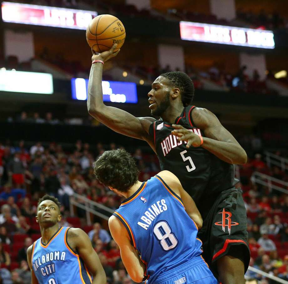 Houston Rockets forward Montrezl Harrell (5) is fouled by Oklahoma City Thunder guard Alex Abrines (8) on his way to the basket during the first quarter of an NBA game at the Toyota Center, Thursday, Jan. 5, 2017, in Houston. ( Jon Shapley / Houston Chronicle ) Photo: Jon Shapley/Houston Chronicle