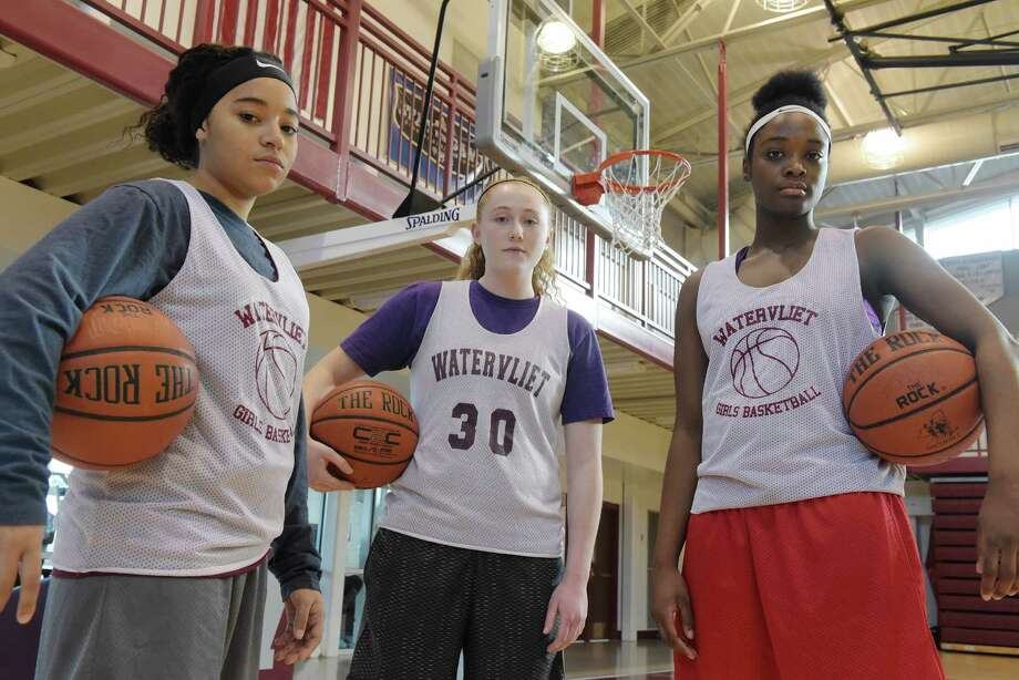 Watervliet girl's basketball players, Saige Roberts, left, Meghan Murray, center, and Ali Changa pose for a photo on Thursday, Jan. 5, 2017, in Watervliet, N.Y.  (Paul Buckowski / Times Union) Photo: PAUL BUCKOWSKI / 20039322A
