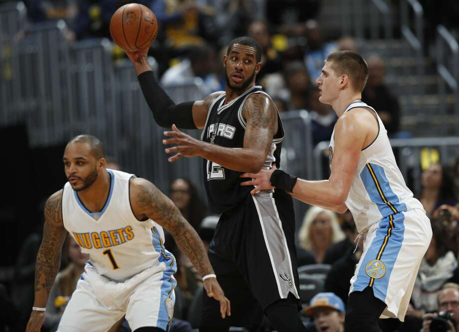 San Antonio Spurs forward LaMarcus Aldridge, center, looks to pass as Denver Nuggets guard Jameer Nelson, left, and forward Nikola Jokic, of Serbia, defend in the first half of an NBA basketball game Thursday, Jan. 5, 2017, in Denver. (AP Photo/David Zalubowski) Photo: David Zalubowski/Associated Press