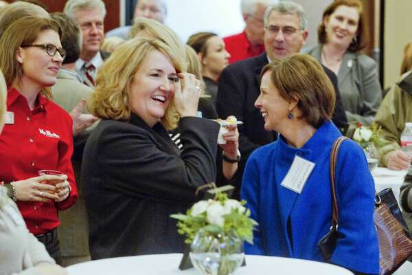 Judge Lisa Michalk, of the 221st state District Court, laughs along side State Board of Education member Barbara Cargill, right, during an appreciation reception for elected officials at the Conroe/Lake Conroe Chamber of Commerce building Thursday, Jan. 5, 2017, in Conroe. Thirty elected officials and representatives attended the event.
