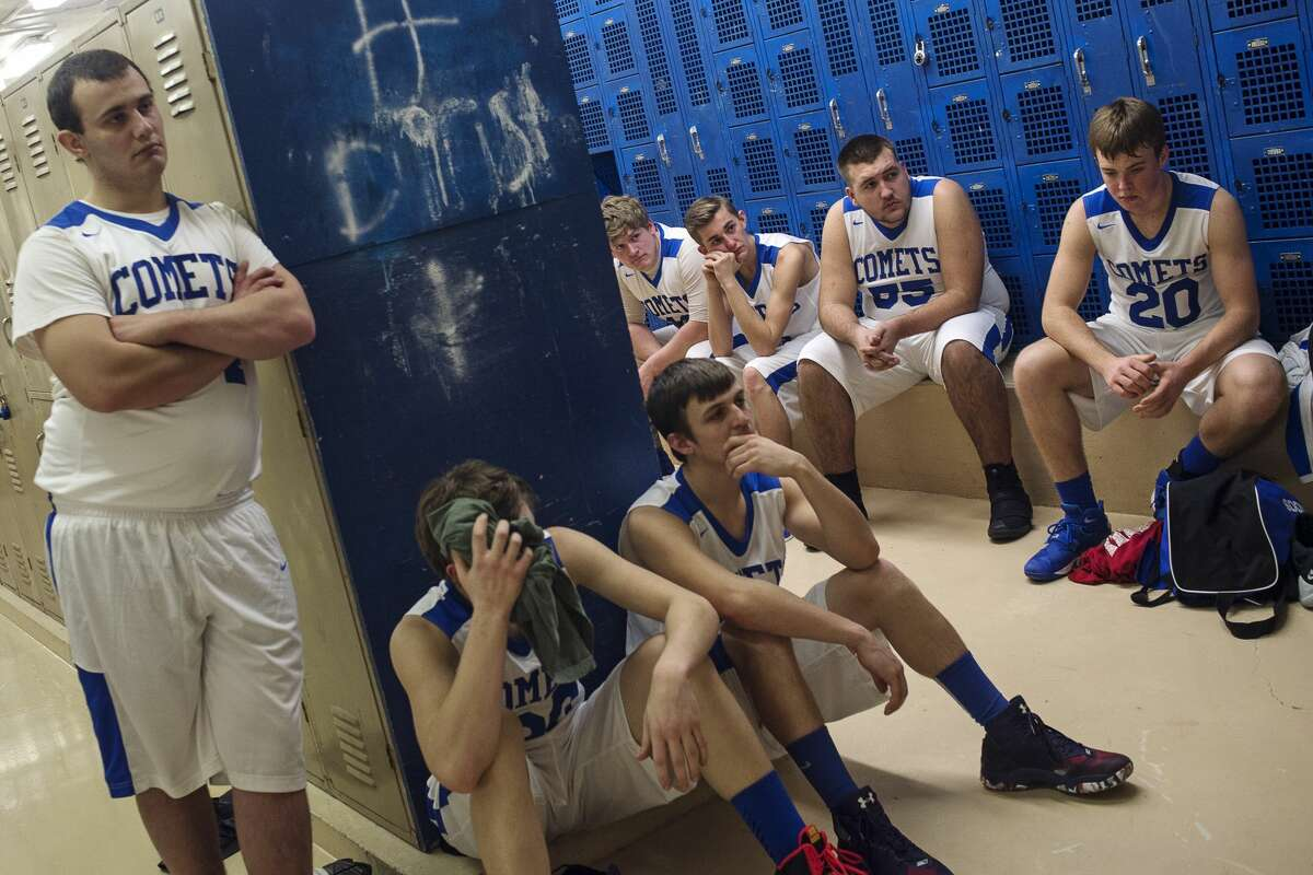 Coleman Basketball listens to coach Steve Fox during halftime on Thursday at Coleman Community High School.