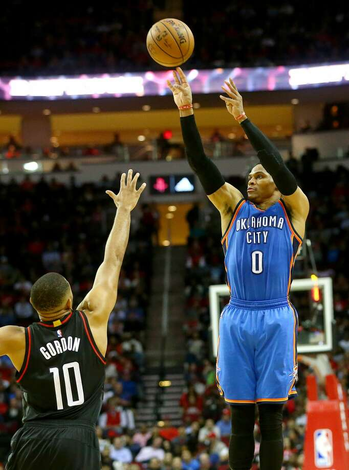 Oklahoma City Thunder guard Russell Westbrook (0) shoots over Houston Rockets guard Eric Gordon (10) during the fourth quarter of an NBA game at the Toyota Center, Thursday, Jan. 5, 2017, in Houston. ( Jon Shapley / Houston Chronicle ) Photo: Jon Shapley/Houston Chronicle